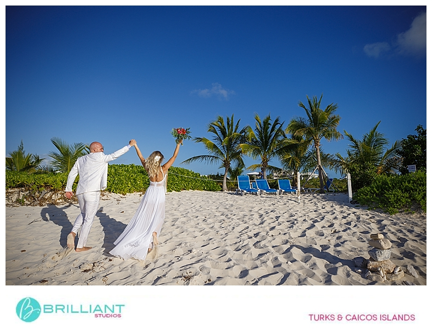 bride and groom celebrating after their beach wedding in providenciales
