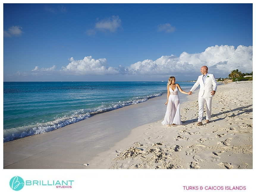 wedding couple walking on the beach in turks and caicos