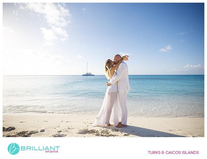 wedding couple kissing on grace bay