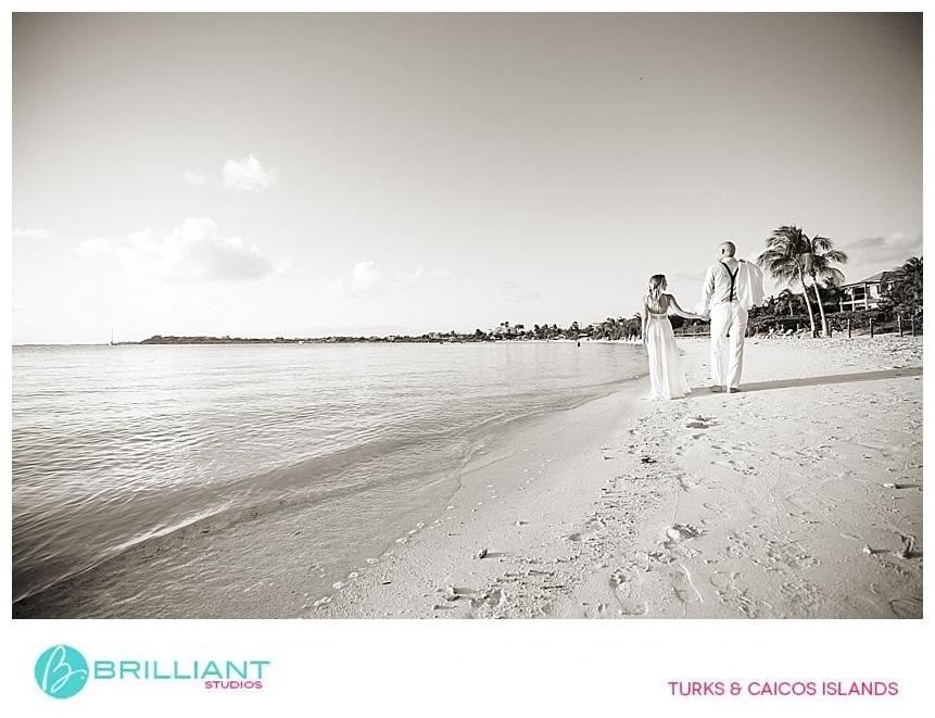 bride and groom walking on Sapodilla Bay