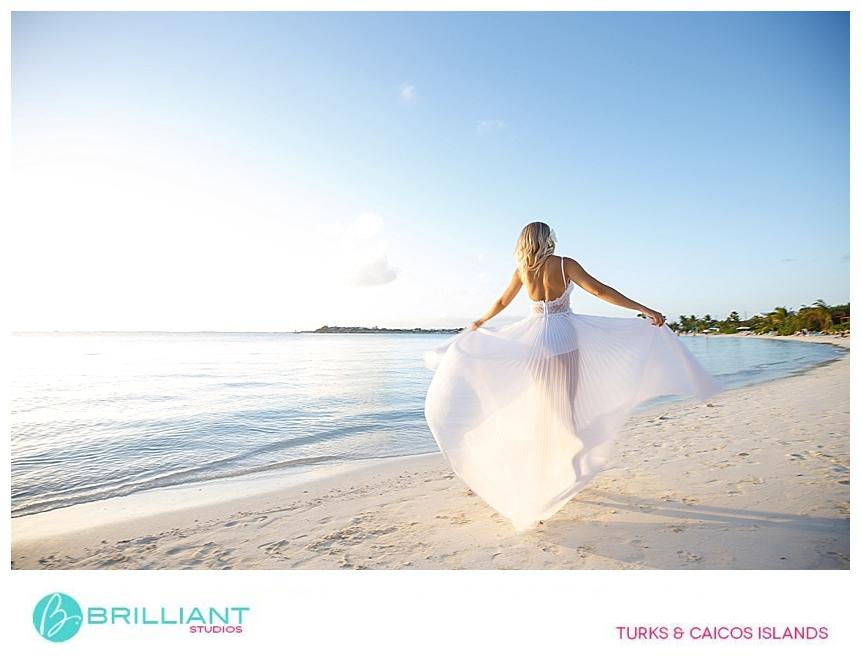 bride playing with her wedding dress at Sapodilla Bay