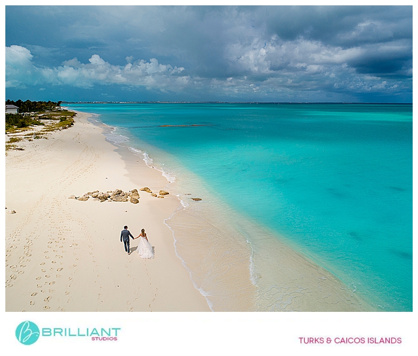 bride and groom walking on the Grace Bay beach