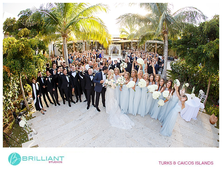 group photo at a destination wedding in turks and caicos