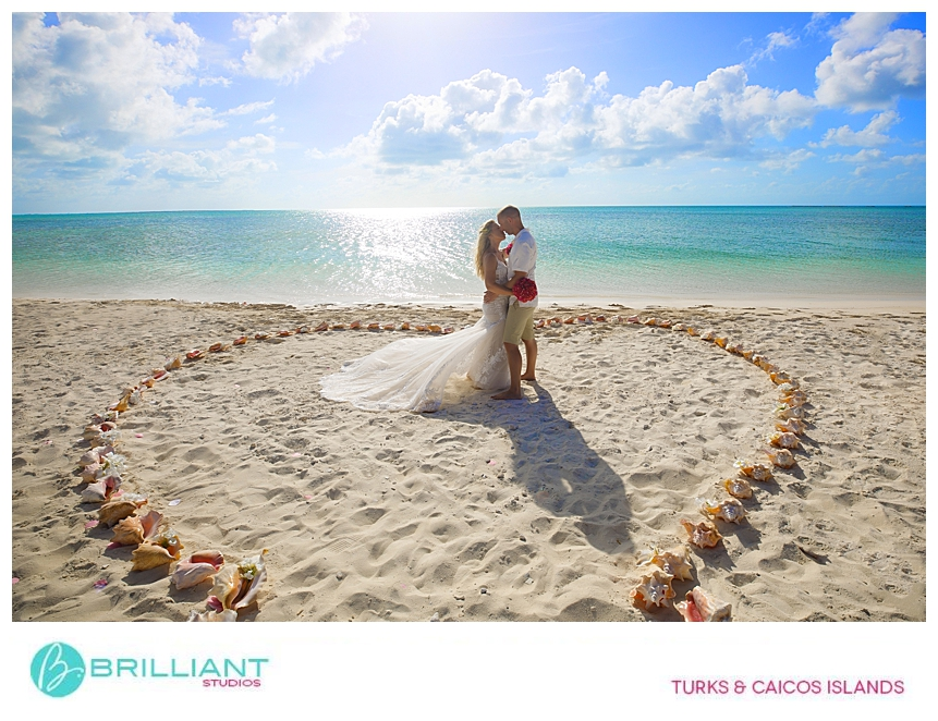 bride and groom being photograph during a Turks and Caicos beach wedding