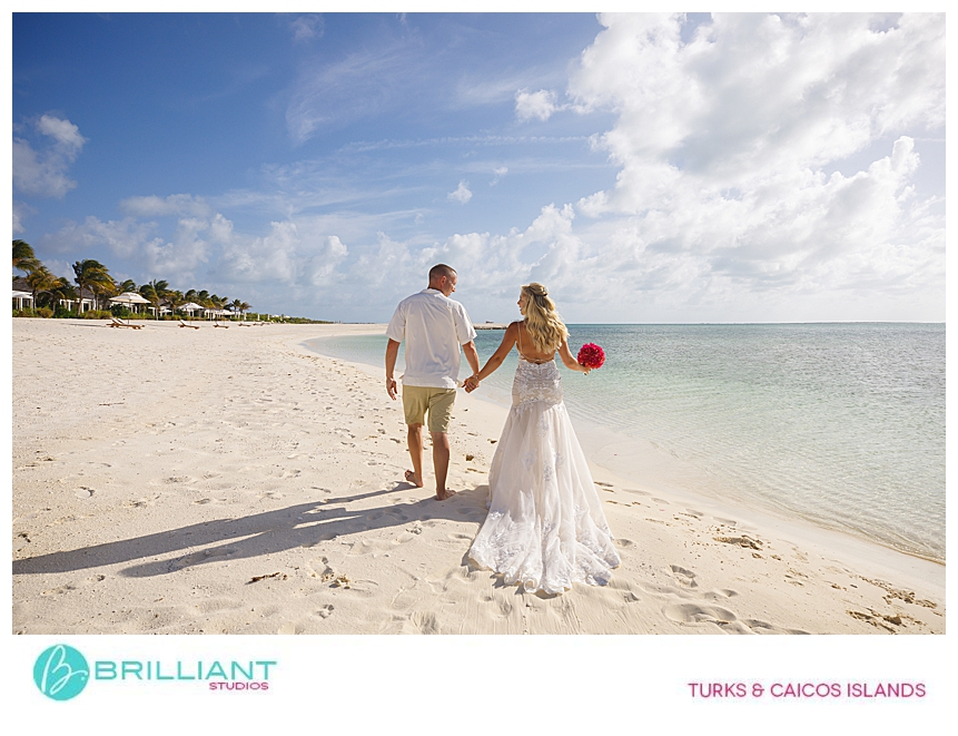 bride and groom walking on a private beach in turks and caicos
