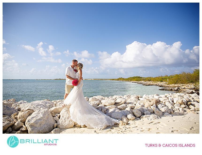 bride and groom taking photos on a Turks and Caicos beach