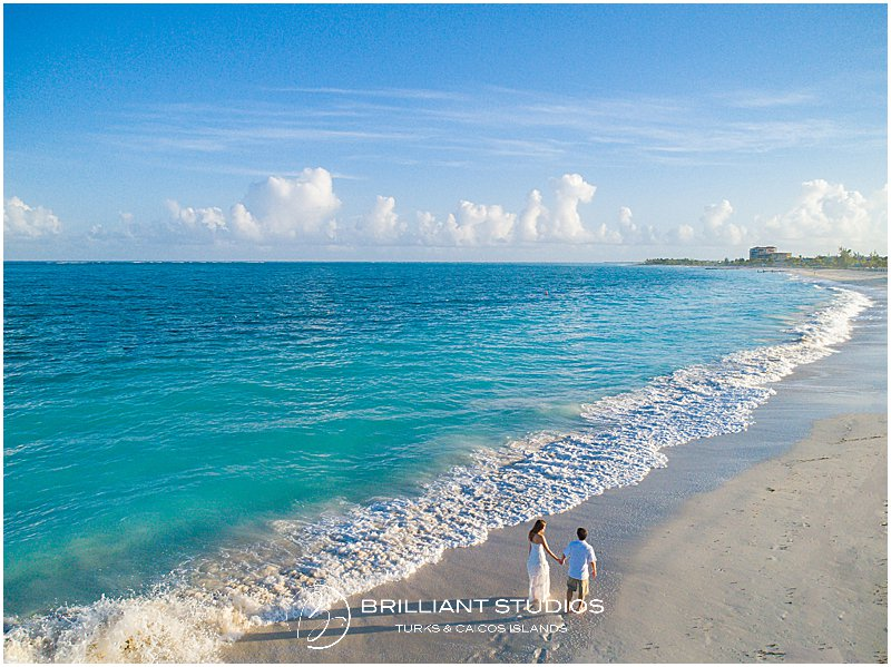 bride and groom walking on Grace Bay beach in the Turks and Caicos Islands