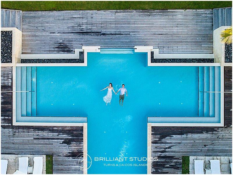 wedding couple floating on Grace Bay Club pool