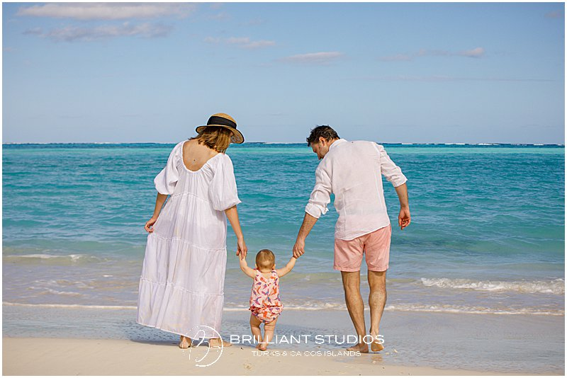 mum dad and baby during a family photo shoot in Turks and Caicos